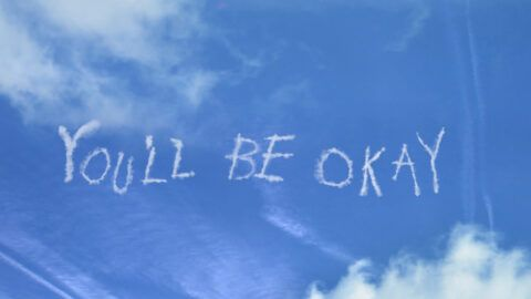 An image of the sky with 'You'll Be Ok' written across it in white