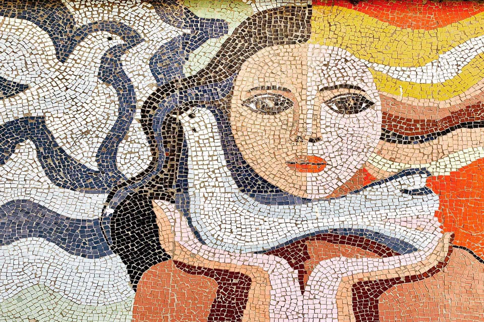 Mosaic tile of a women holding a bird