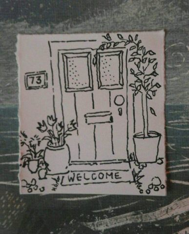 A sketch of a front door with a welcome matt and plants