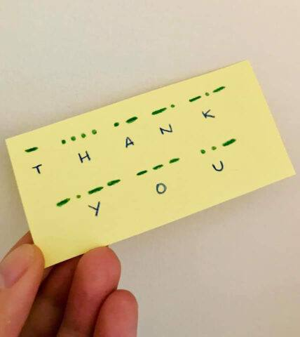 A post it note saying thank you